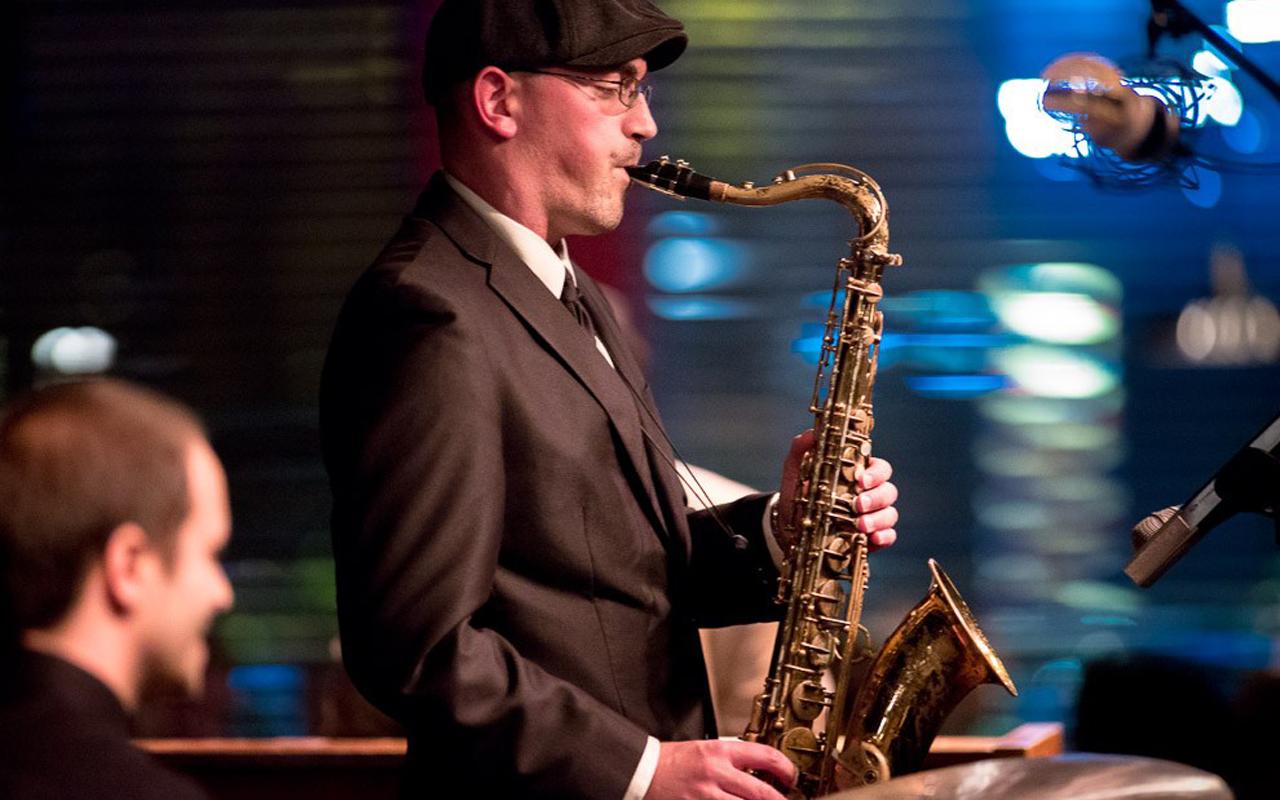 Kareem Kandi playing saxophone