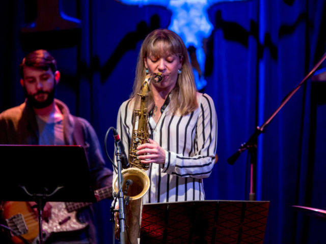 Kate Olson playing saxophone, photo by Daniel Sheehan.