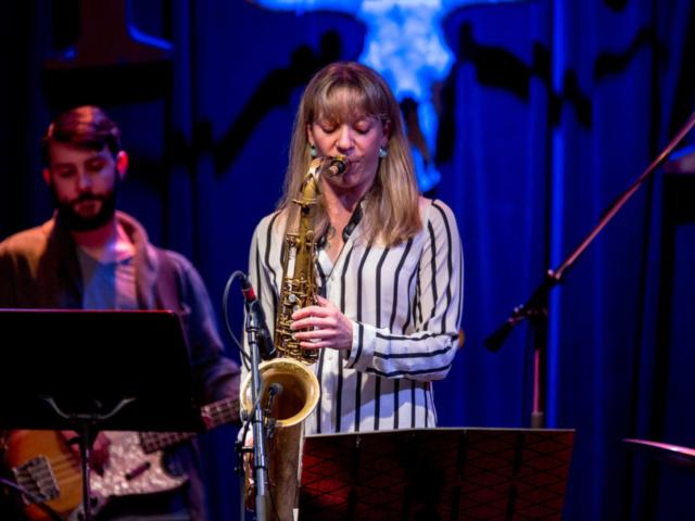 Kate Olson playing saxophone, photo by Daniel Sheehan.