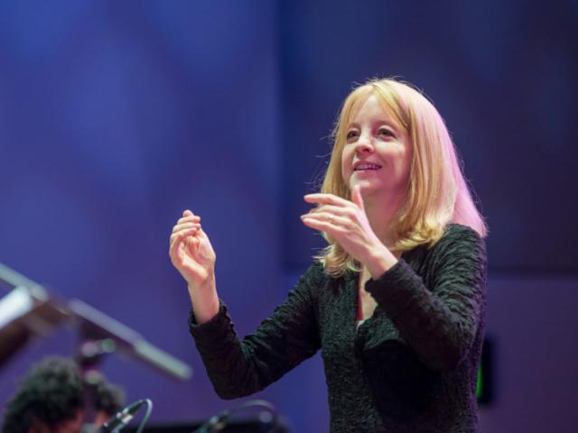 Maria Schneider conducting the SRJO, photo by Daniel Sheehan.