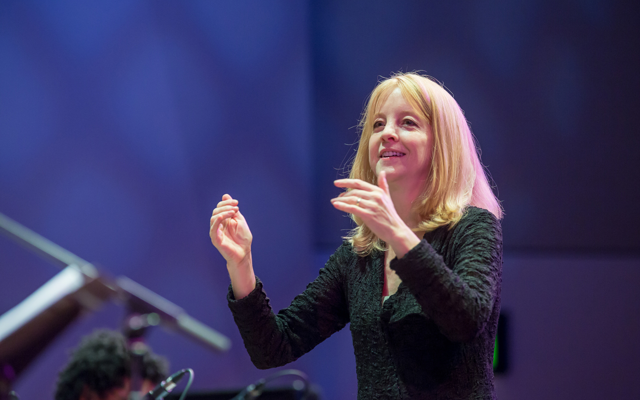 Maria Schneider conducting the SRJO, photo by Daniel Sheehan.