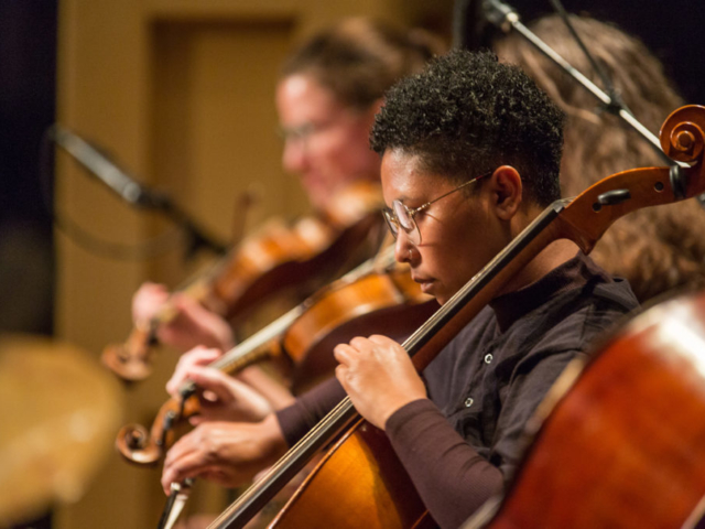 Ebony Miranda playing the cello, photo by Daniel Sheehan.