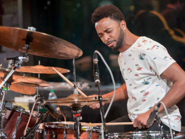 Ryan J Lee playing drums, photo by Daniel Sheehan.