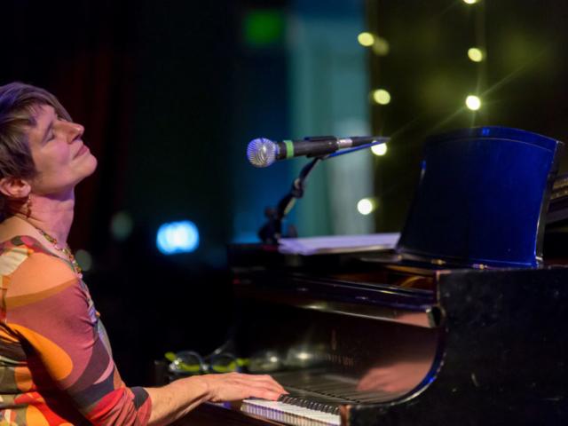 Ann Reynolds playing piano, photo by Daniel Sheehan.