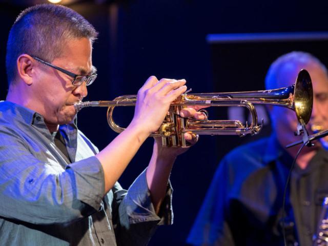 Cuong Vu playing trumpet, photo by Daniel Sheehan.