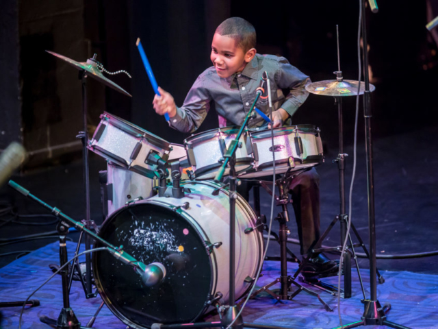 Donovon Kranzler-Lewis playing drums, photo by Daniel Sheehan.
