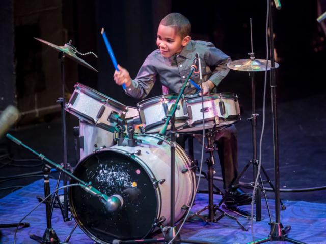 Donovon Kranzler-Lewis playing drums, photo by Daniel Sheehan.