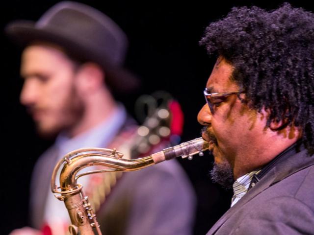 Alex Dugdale playing saxophone, photo by Daniel Sheehan.