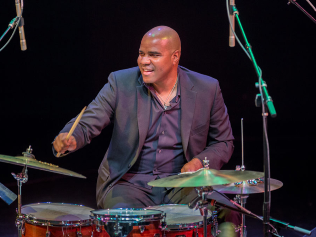 D'Vonne Lewis Playing drums, photo by Daniel Sheehan.