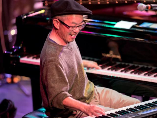 Deems Tsutakawa playing piano and keyboard, photo by Daniel Sheehan.