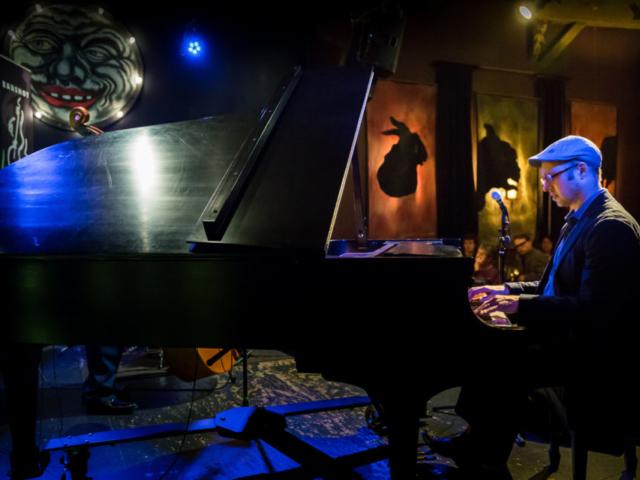 George Colligan playing piano, photo by Daniel Sheehan.