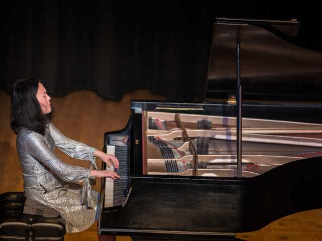 Helen Sung playing piano, photo by Daniel Sheehan.