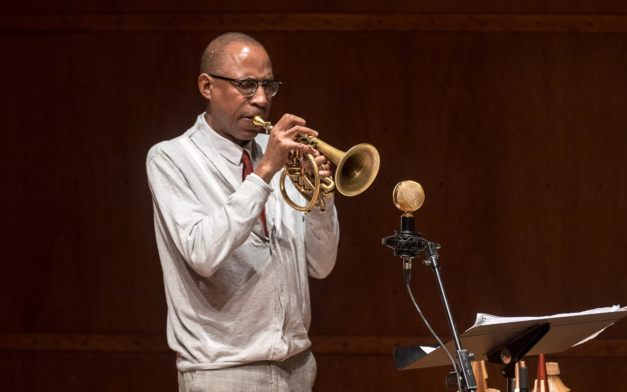 Ron Miles playing the horn, photo by Daniel Sheehan.