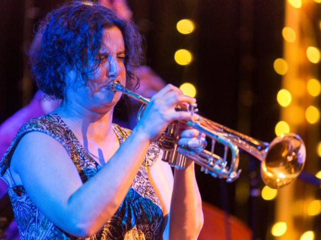 Samantha Boshnack playing trumpet, photo by Daniel Sheehan.