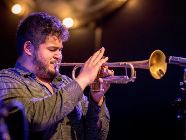 Adam O'Farrill playing trumpet, photo by Daniel Sheehan.
