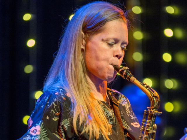 Caroline Davis playing saxophone, photo by Daniel Sheehan.