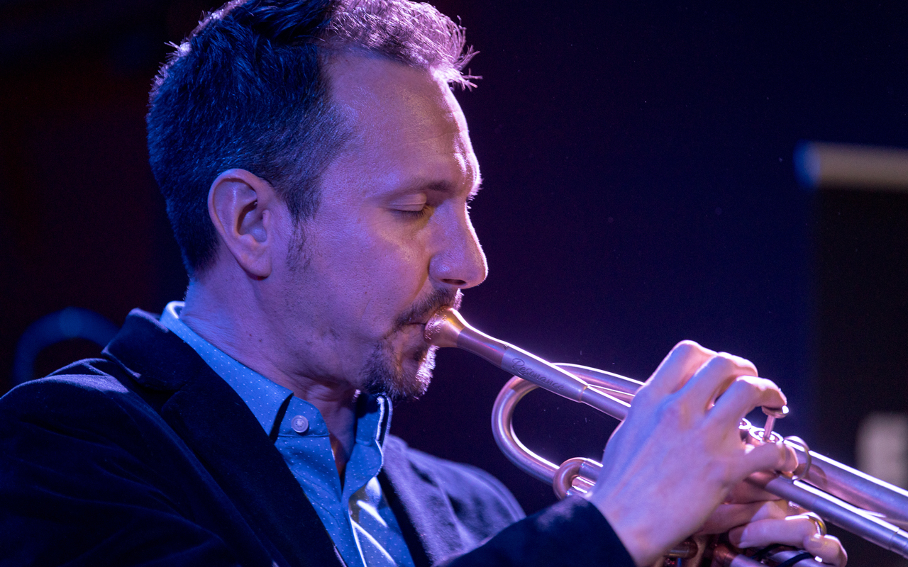Chad McCullough playing trumpet, photo by Daniel Sheehan.