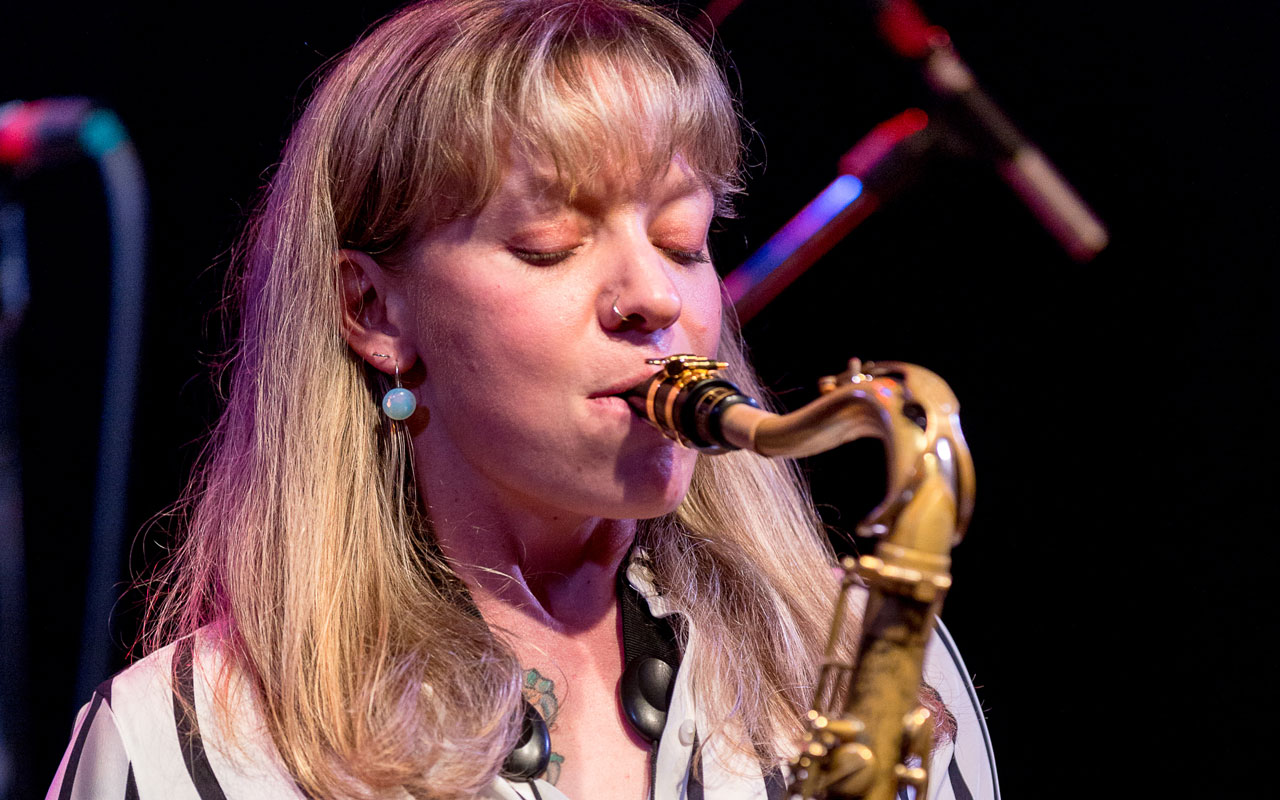 Kate Olson playing a saxophone