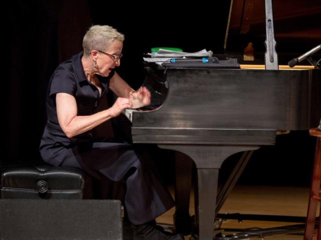 Myra Melford playing piano, photo by Daniel Sheehan.