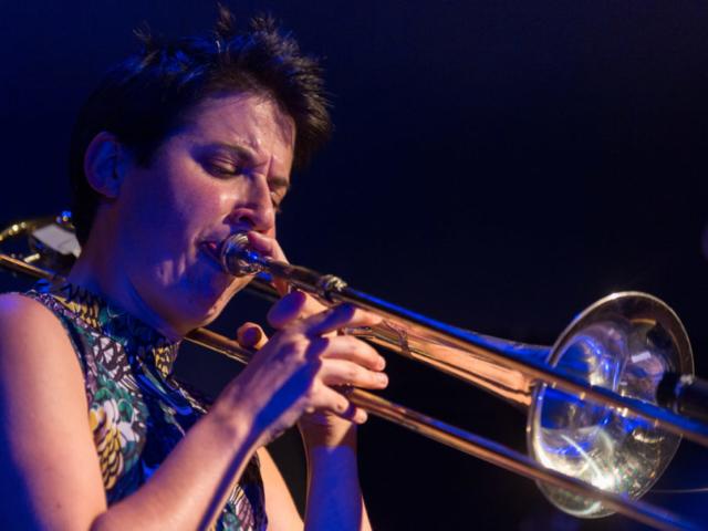 Naomi Moon Siegel playing trombone, photo by Daniel Sheehan.