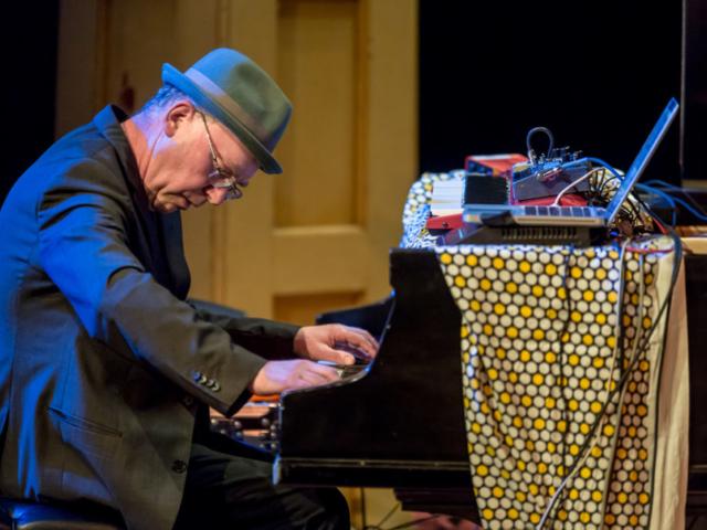 Wayne Horvitz playing piano, photo by Daniel Sheehan.