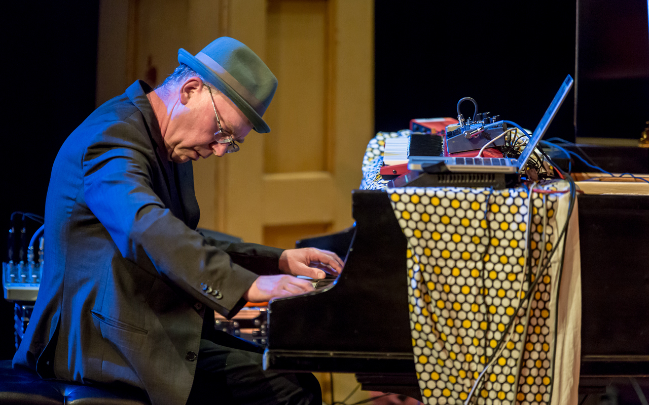Wayne Horvitz playing piano, photo by Daniel Sheehan.