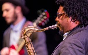 Alex Dugdale playing saxophone