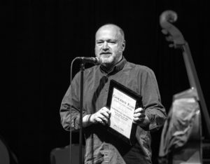 Michael Brockman accepting  the award on behalf of the Seattle Repertory Jazz Orchestra.