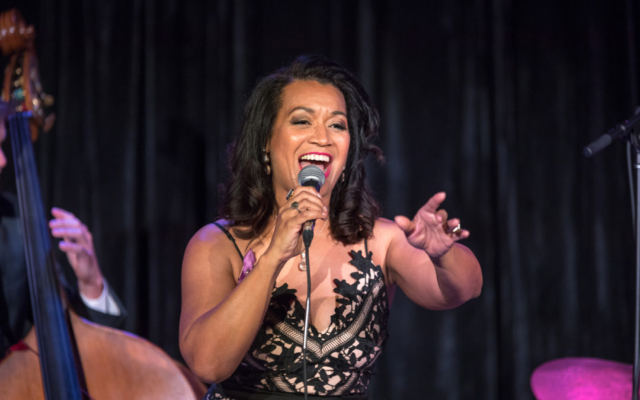 Jacquline Tabor singing with a big smile on her face.