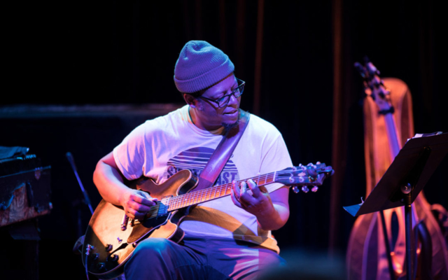 Jeff Parker playing the guitar.