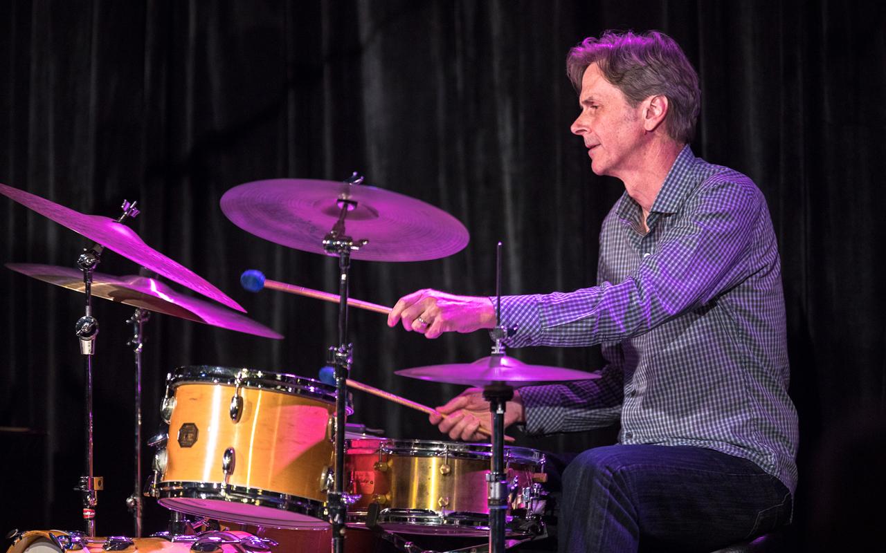 John Bishop drumming.