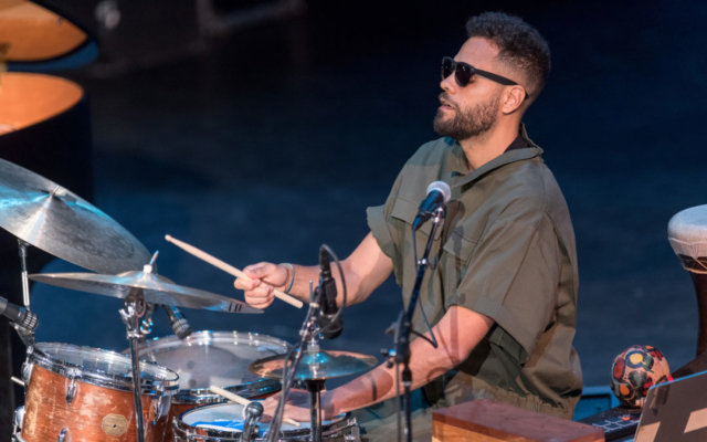 Kassa Overall playing drums.