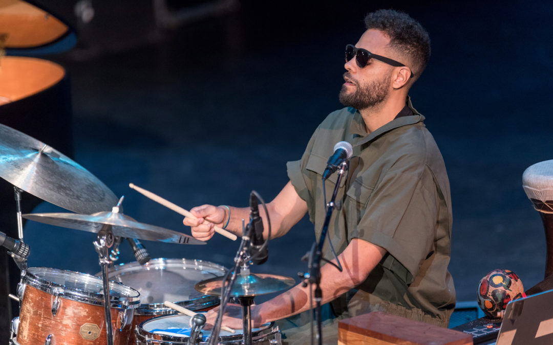 Kassa Overall playing drums at the Langston Hughes Performing Arts Institute