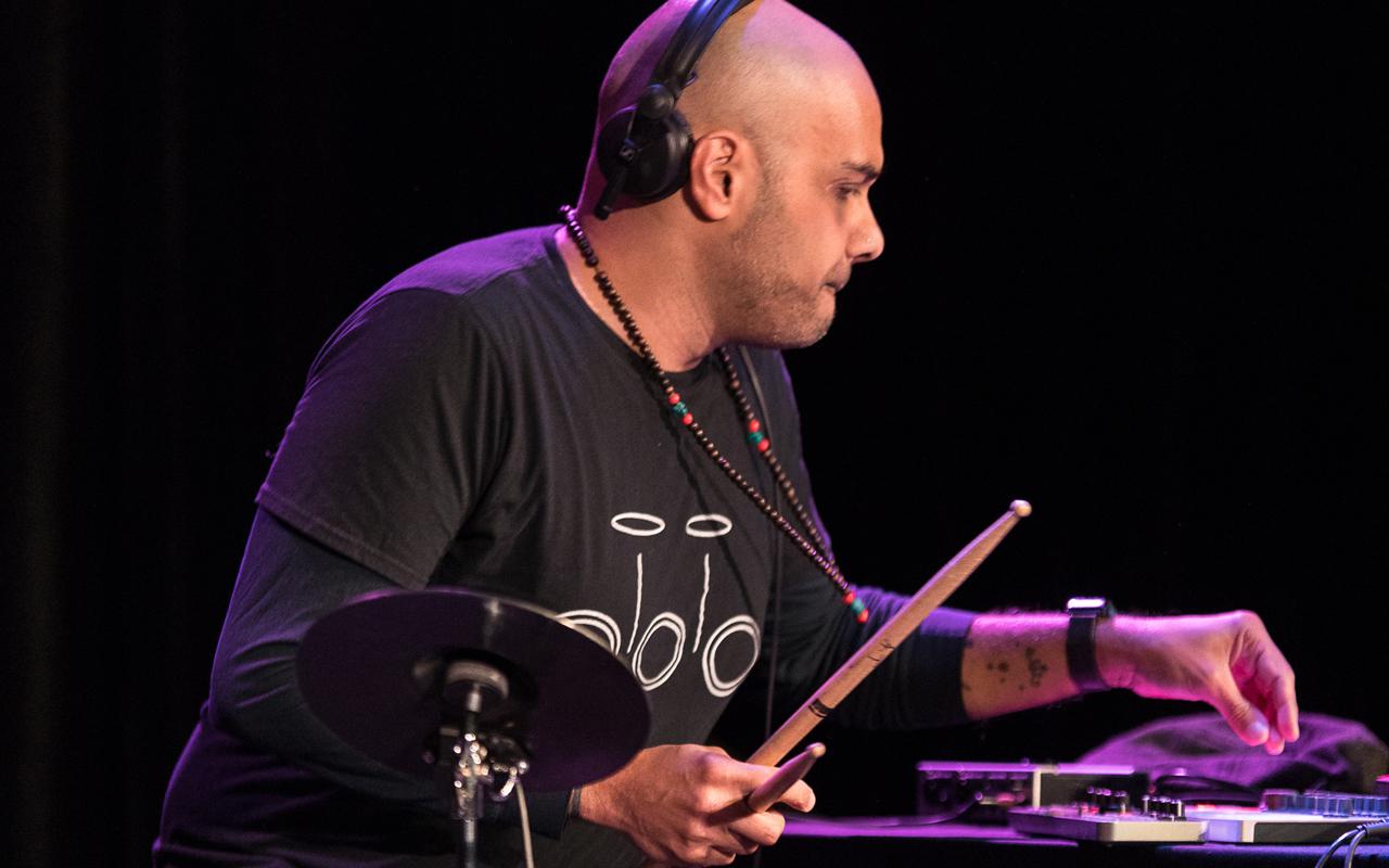 Ravish Momin playing electronic percussion.