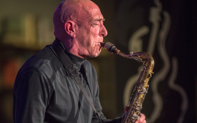 Rick Mandyck playing the saxophone.
