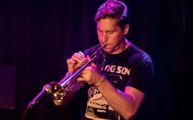 Shane Endsley playing the trumpet.