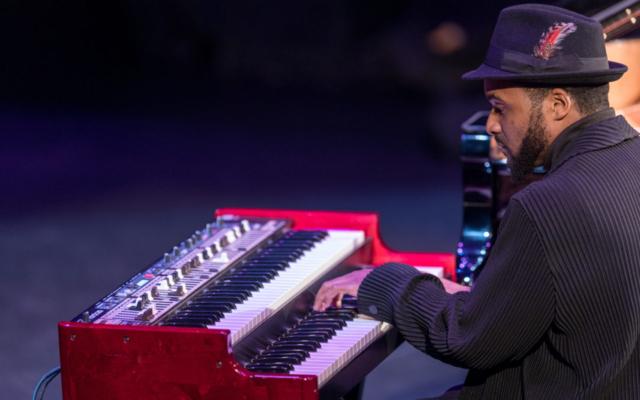 Sullivan Fortner playing the keyboard.