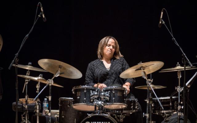 Terri Lyne Carrington playing the drums.