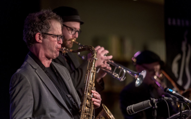 Anton Schwartz and other musicians playing at the Town Hall Seattle.