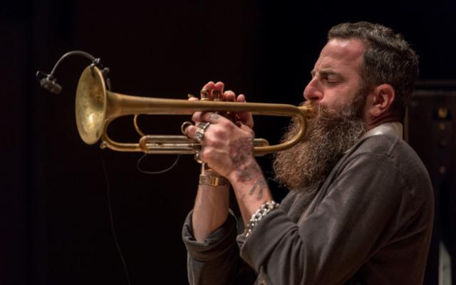 Avishai Cohen playing the trumpet.