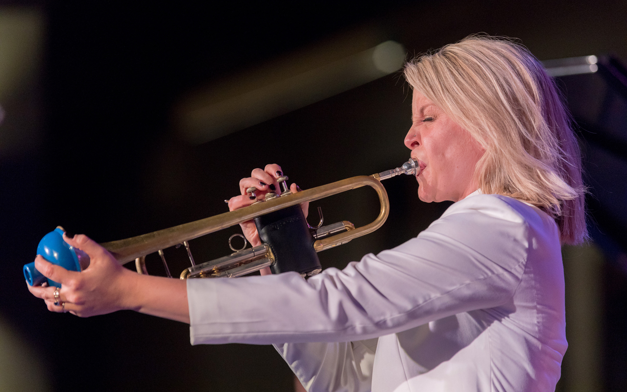 Bria Skonberg playing the trumpet.