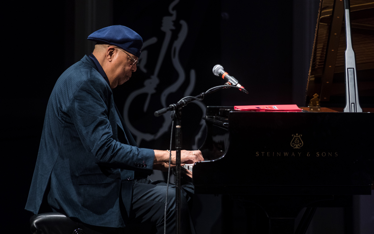 Chucho Valdes playing the piano.