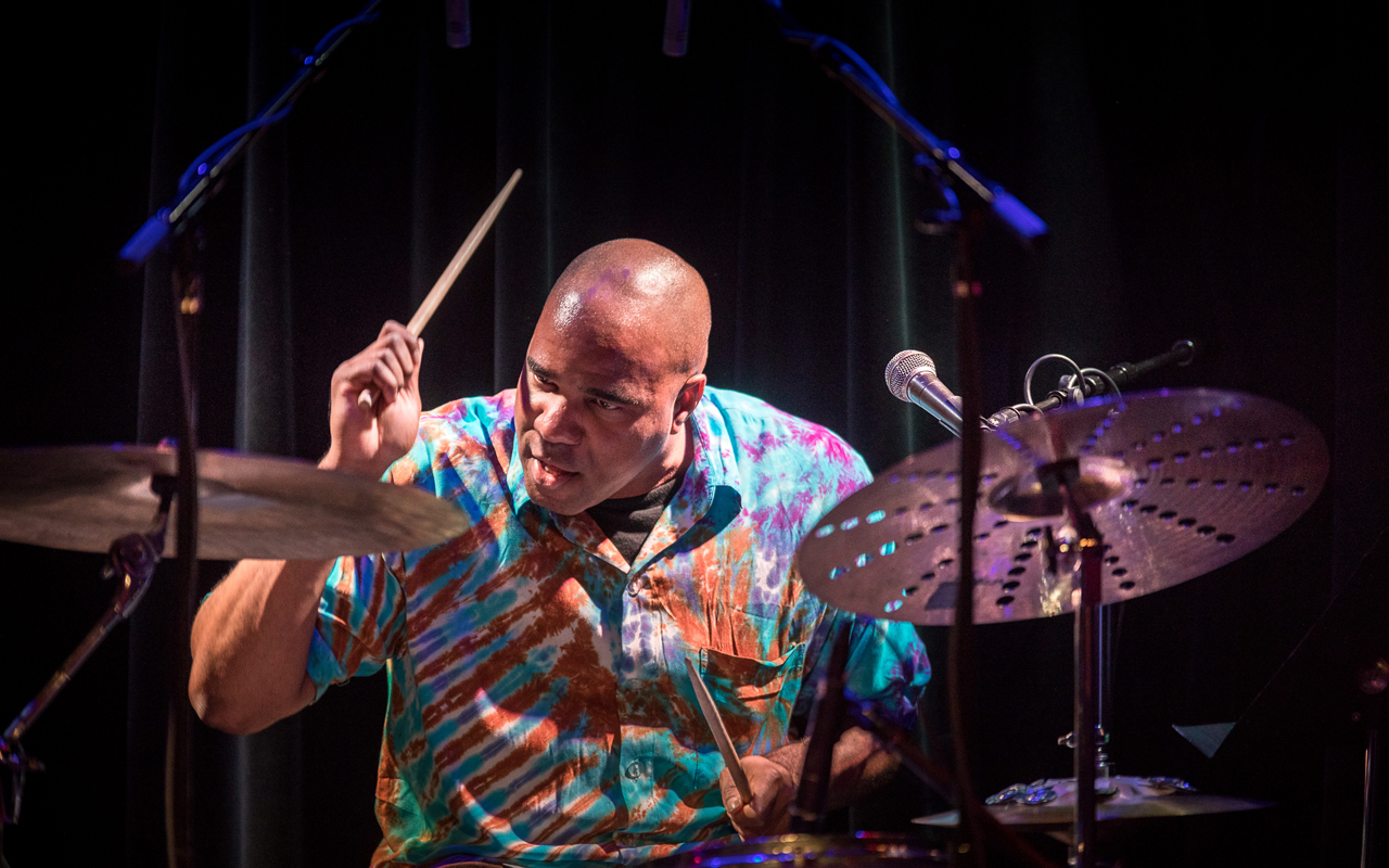 D'Vonne Lewis playing drums