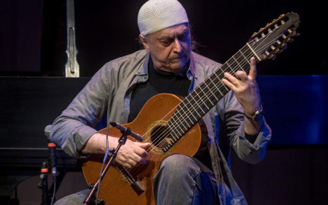 Egberto Gismonti playing the guitar.