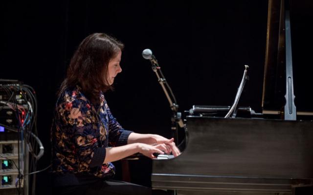 Kris Davis playing piano.