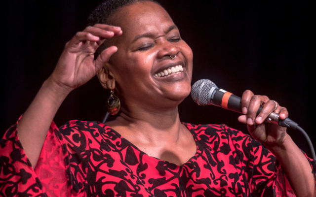 LaVon Hardison singing with a smile on her face.