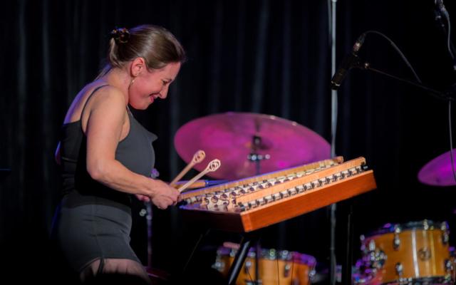 Marina Albero playing the hammered dulcimer.
