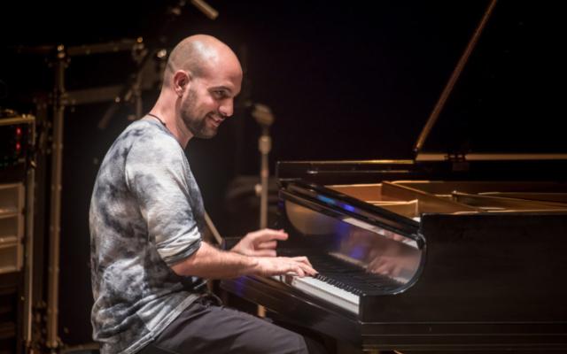 Shai Maestro playing the piano.