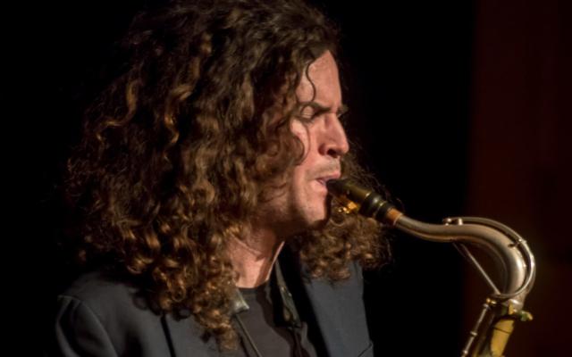 Travis Laplante playing the saxophone.