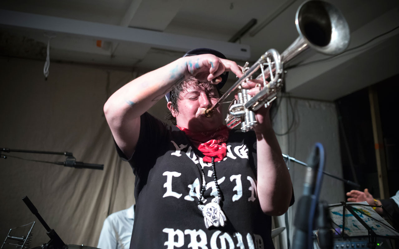 Jaimie Branch playing a trumpet